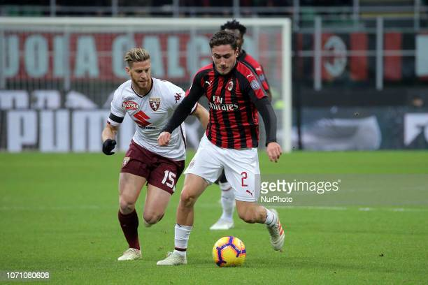 Davide Calabria of AC Milan competes for the ball with Cristian Ansaldi of Torino FC during the serie A match between AC Milan and Torino FC at...