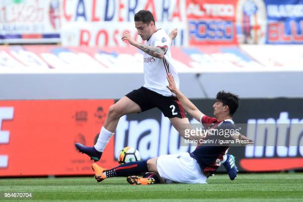 Davide Calabria of AC Milan competes the ball with Riccardo Orsolini of Bologna FC during the serie A match between Bologna FC and AC Milan at Stadio...