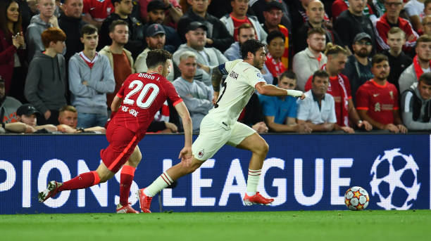 Davide Calabria of AC Milan is chased by Diogo Jota of Liverpool during the UEFA Champions League group B match between Liverpool FC and AC Milan at...