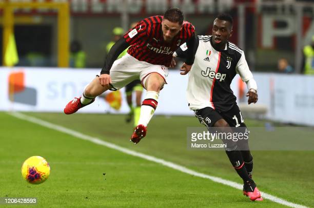 Davide Calabria of Juventus competes for the ball with Blaise Matuidi of AC Milan during the Coppa Italia Semi Final match between AC Milan and...