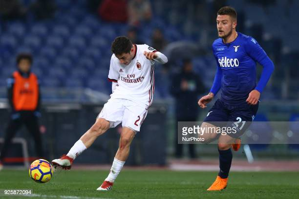 Davide Calabria of Milan and Sergej MilinkovicSavic of Lazio during the TIM Cup match between SS Lazio and AC Milan at Olimpico Stadium on February...