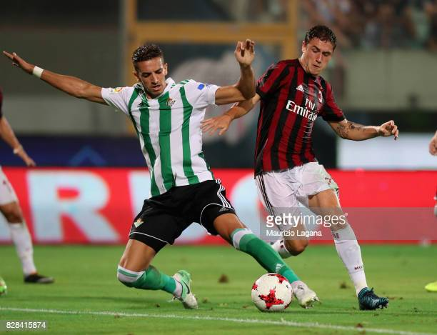 Davide Calabria of Milan competes for the ball with Zouhair Feddal of Real Betis during the PreSeason Friendly match between AC Milan and Villareal...