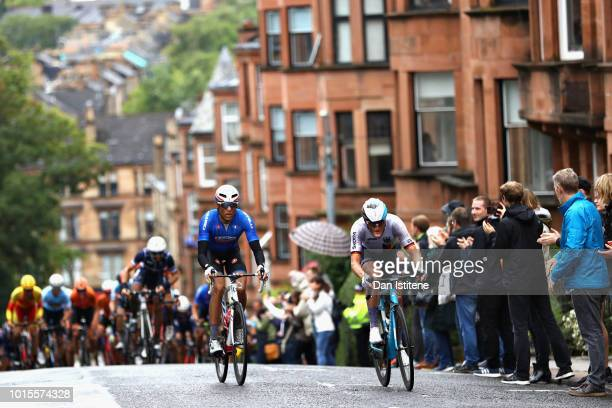 Davide Cimolai of Italy and Nico Denz of Germany attempt to start a breakaway in the Men's Road Race during the road cycling on Day Eleven of the...