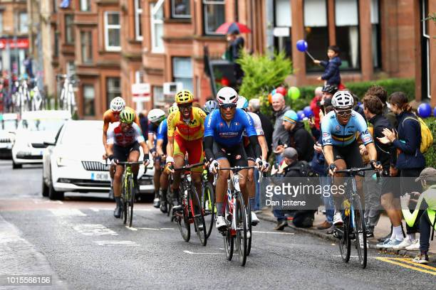 Davide Cimolai of Italy and Wout Van Aert of Belgium lead the leading pack in the Men's Road Race during the road cycling on Day Eleven of the...