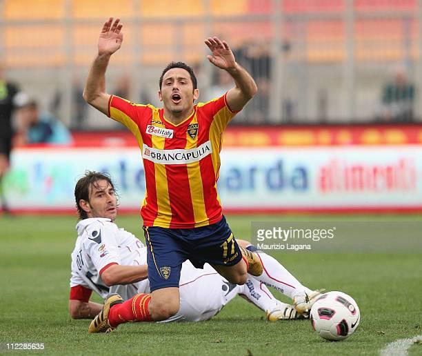 Davide Di Michele of Lecce is challenged by Daniele Conti of Cagliari during the Serie A match between Lecce and Cagliari Calcio at Stadio Via del...