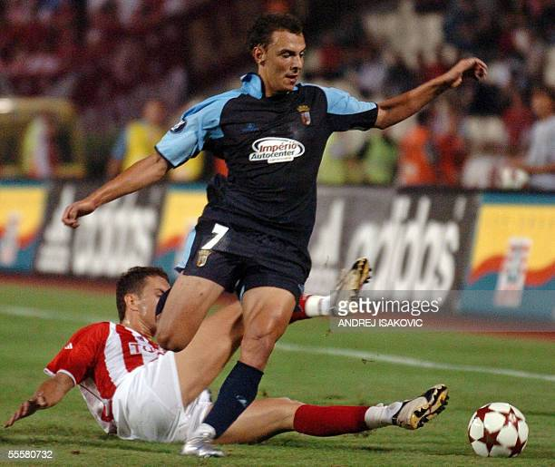 Davide Dias from Braga vies Bosko Jankovic from Crvena Zvezda Belgrade during their UEFA Cup first round first leg football match in Belgrade 15...