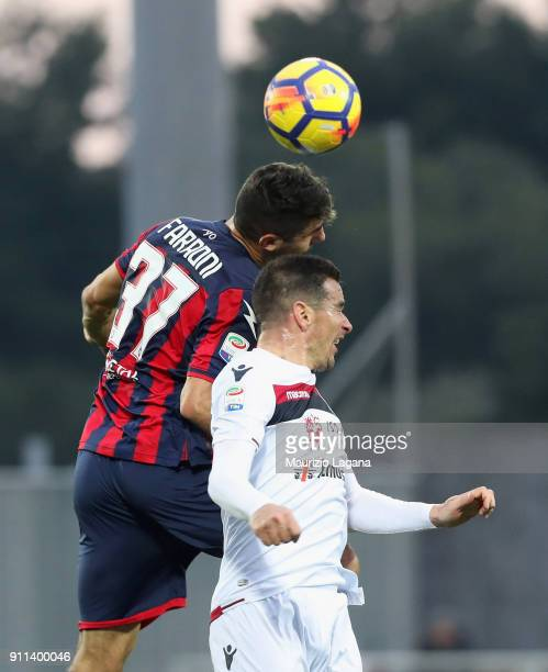 Davide Faraoni of Crotone competes for the ball in air with Simone Padoin of Cagliari during the serie A match between FC Crotone and Cagliari Calcio...