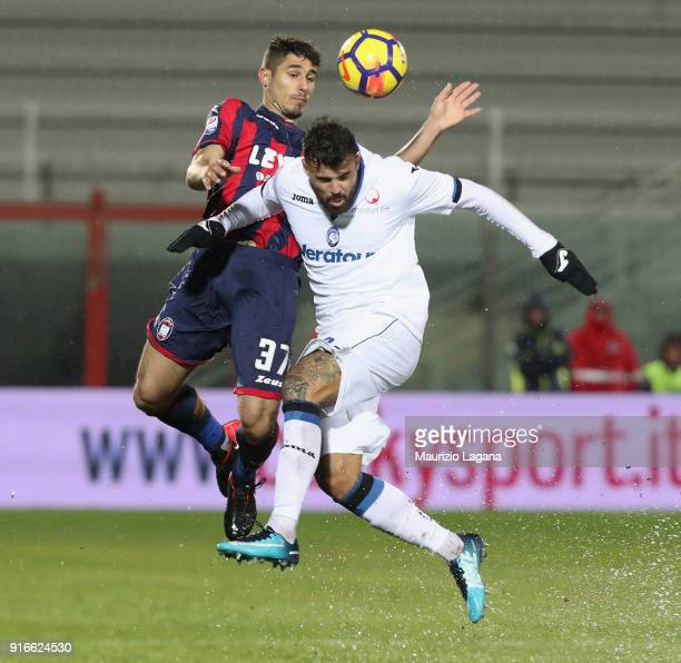 Davide Faraoni of Crotone competes for the ball with Andrea Petagna of Atalanta during the serie A match between FC Crotone and Atalanta BC at Stadio...