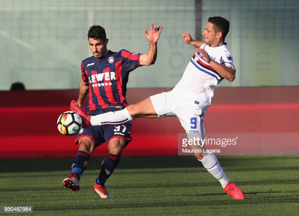 Davide Faraoni of Crotone competes for the ball with Gianluca Caprari of Sampdoria during the serie A match between FC Crotone and UC Sampdoria at...