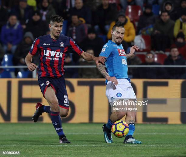 Davide Faraoni of Crotone competes for the ball with Marek Hamsik of Napoli during the serie A match between FC Crotone and SSC Napoli at Stadio...