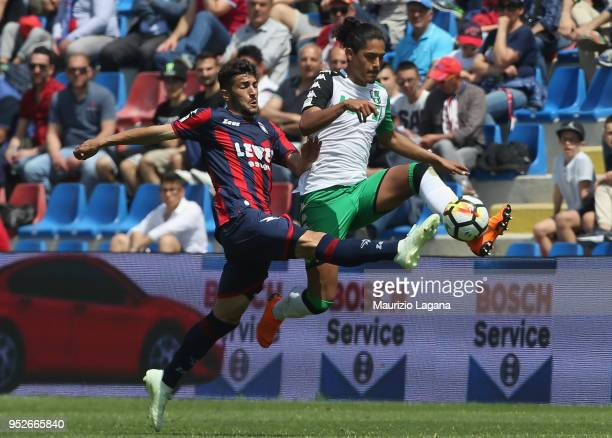 Davide Faraoni of Crotone competes for the ball with Mauricio Lemosi of Sassuolo during the serie A match between FC Crotone and US Sassuolo at...
