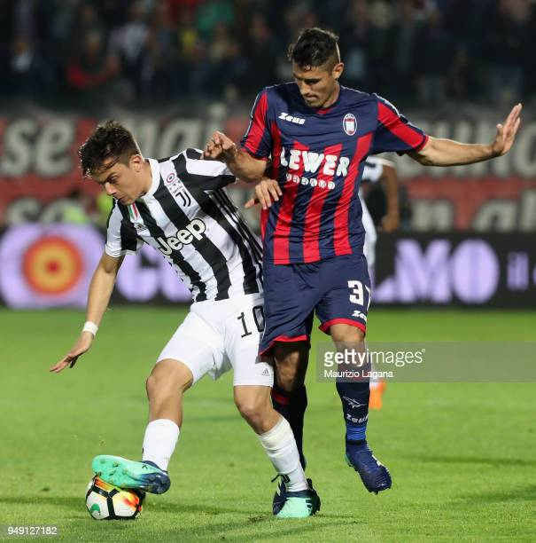 Davide Faraoni of Crotone competes for the ball with Paulo Dybala of Juventus during the serie A match between FC Crotone and Juventus at Stadio...