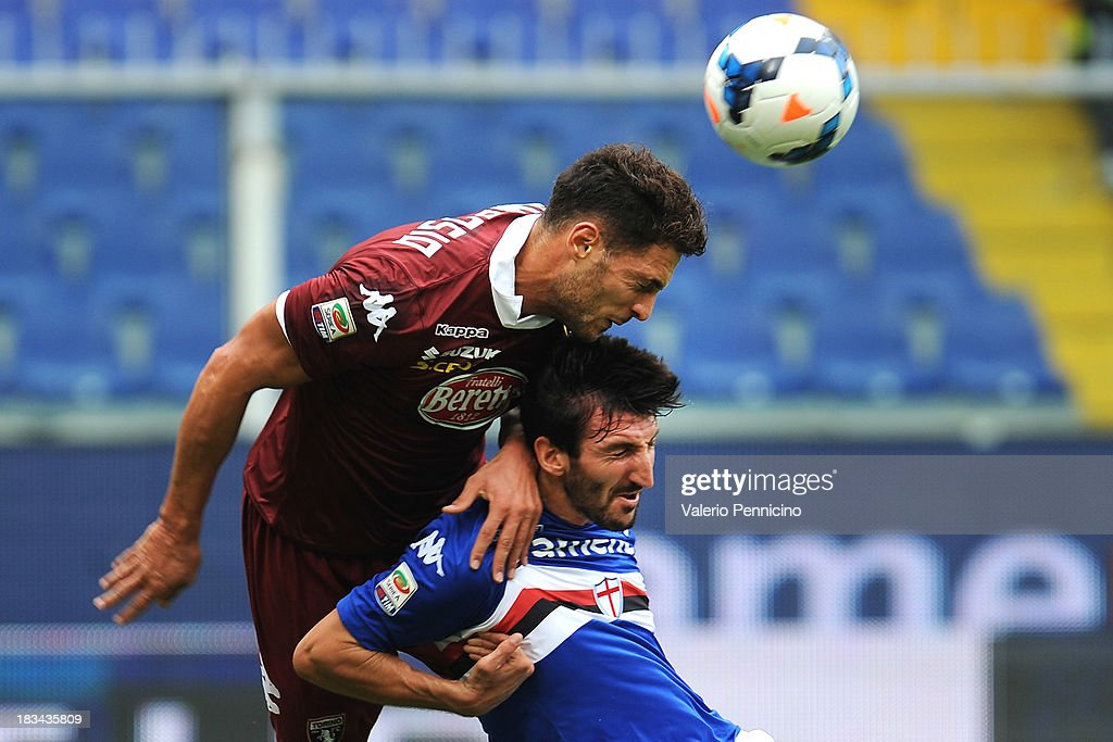 Davide Gavazzi (R) of UC Sampdoria clashes with Danilo D Ambrosio of Torino FC during the Serie A match between UC Sampdoria and Torino FC at Stadio Luigi Ferraris on October 6, 2013 in Genoa, Italy.