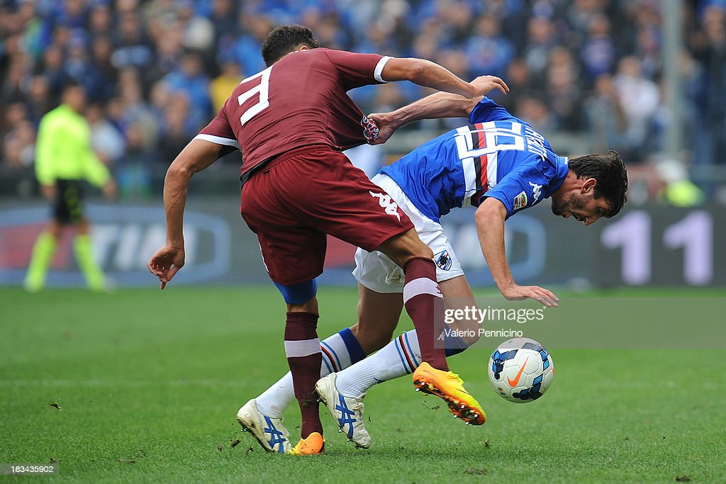 Davide Gavazzi (R) of UC Sampdoria is challenged by Danilo D Ambrosio of Torino FC during the Serie A match between UC Sampdoria and Torino FC at Stadio Luigi Ferraris on October 6, 2013 in Genoa, Italy.