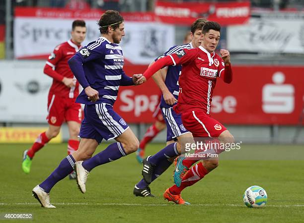 Davide Grassi of Osnabrueck battles for the ball with Tim Kleindienst of Cottbus during the third league match between FC Energie Cottbus and VFL...