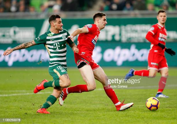 Davide Lanzafame of Ferencvarosi TC challenges Tomislav Mazalovic of DVTK during the Hungarian OTP Bank Liga match between Ferencvarosi TC and DVTK...