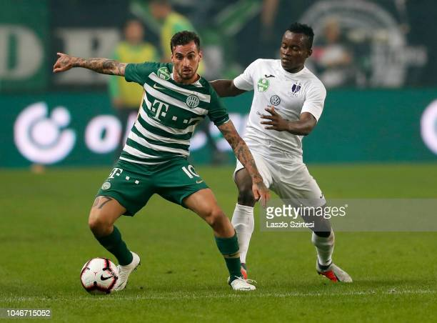 Davide Lanzafame of Ferencvarosi TC competes for the ball with Vincent Onovo of Ujpest FC during the Hungarian OTP Bank Liga match between...