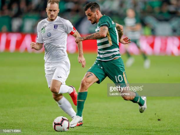 Davide Lanzafame of Ferencvarosi TC competes for the ball with Robert Litauszki of Ujpest FC during the Hungarian OTP Bank Liga match between...
