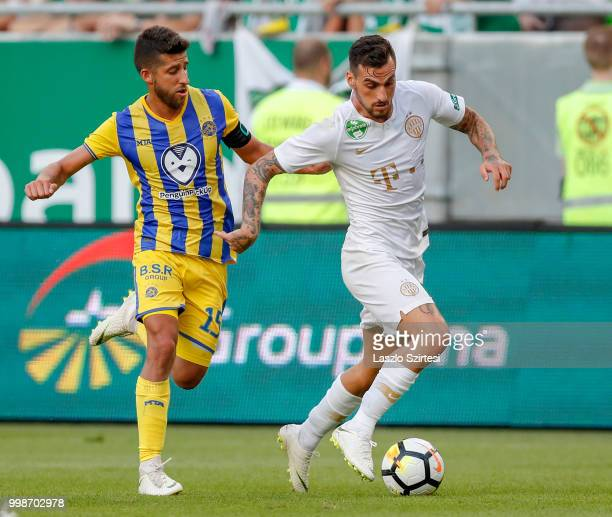 Davide Lanzafame of Ferencvarosi TC wins the ball from Dor Micha of Maccabi Tel Aviv FC during the UEFA Europa League First Qualifying Round 1st Leg...