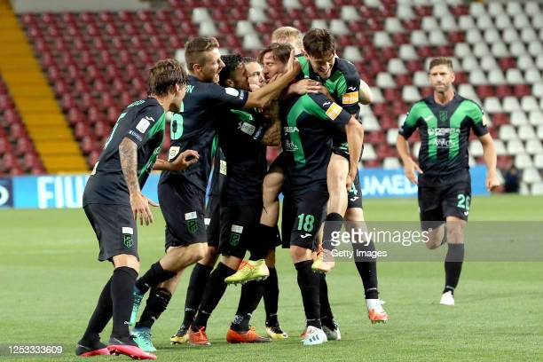 Davide Mazzocco of Pordenone celebrates after scoring his team's first goal with teammates during the serie B match between Pordenone Calcio and...