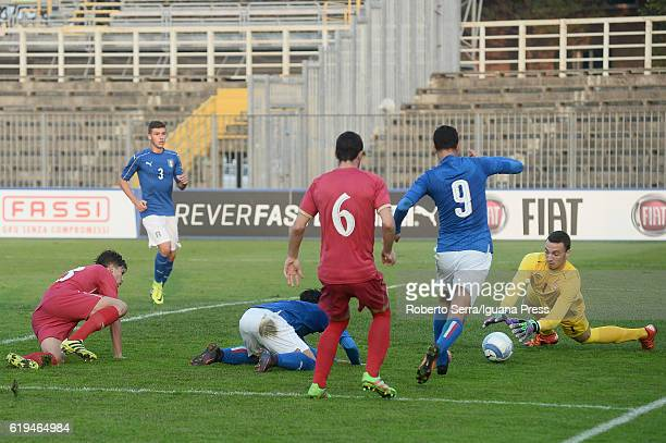 Davide Merola and Pietro Pellegri of Italy handles the ball during the UEFA European Under17 Championship Qualifier between Italy and Serbia at...