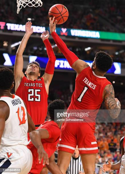 Davide Moretti and Brandone Francis of the Texas Tech Red Raiders compete for a loose ball during the second half of the 2019 NCAA men's Final Four...