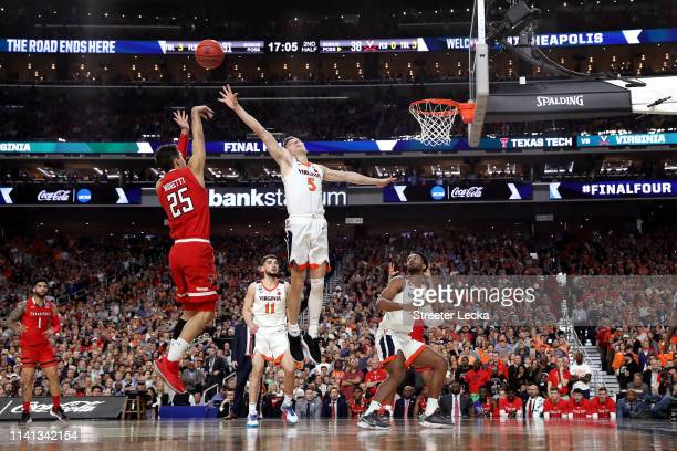 Davide Moretti of the Texas Tech Red Raiders attempts a shot against Kyle Guy of the Virginia Cavaliers in the second half during the 2019 NCAA men's...