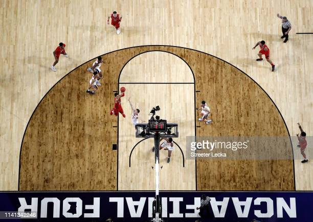 Davide Moretti of the Texas Tech Red Raiders attempts a shot against Kyle Guy of the Virginia Cavaliers in the first half during the 2019 NCAA men's...