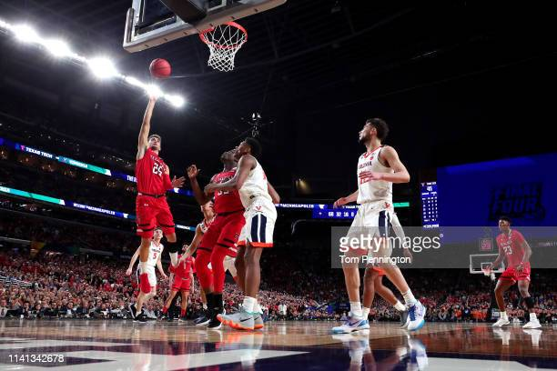 Davide Moretti of the Texas Tech Red Raiders attempts a shot against the Virginia Cavaliers in the second half during the 2019 NCAA men's Final Four...