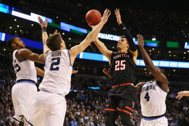 Davide Moretti of the Texas Tech Red Raiders drives to the basket during the first half against the Villanova Wildcats in the 2018 NCAA Men's...