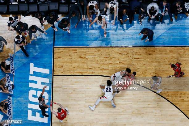 Davide Moretti of the Texas Tech Red Raiders fights for the ball against Josh Perkins and Jeremy Jones of the Gonzaga Bulldogs during the second half...