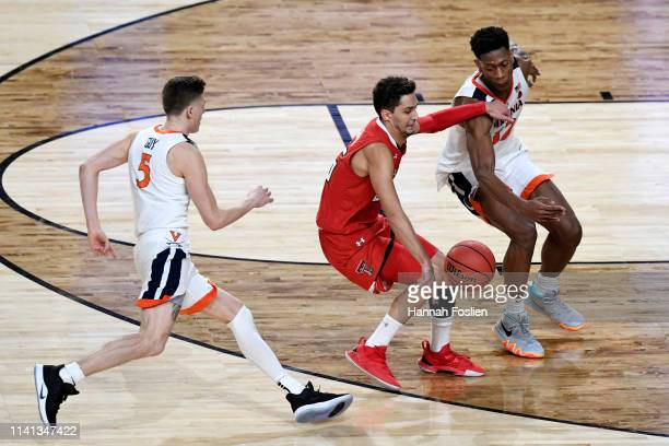 Davide Moretti of the Texas Tech Red Raiders is defended by v5 during the 2019 NCAA men's Final Four National Championship game at US Bank Stadium on...