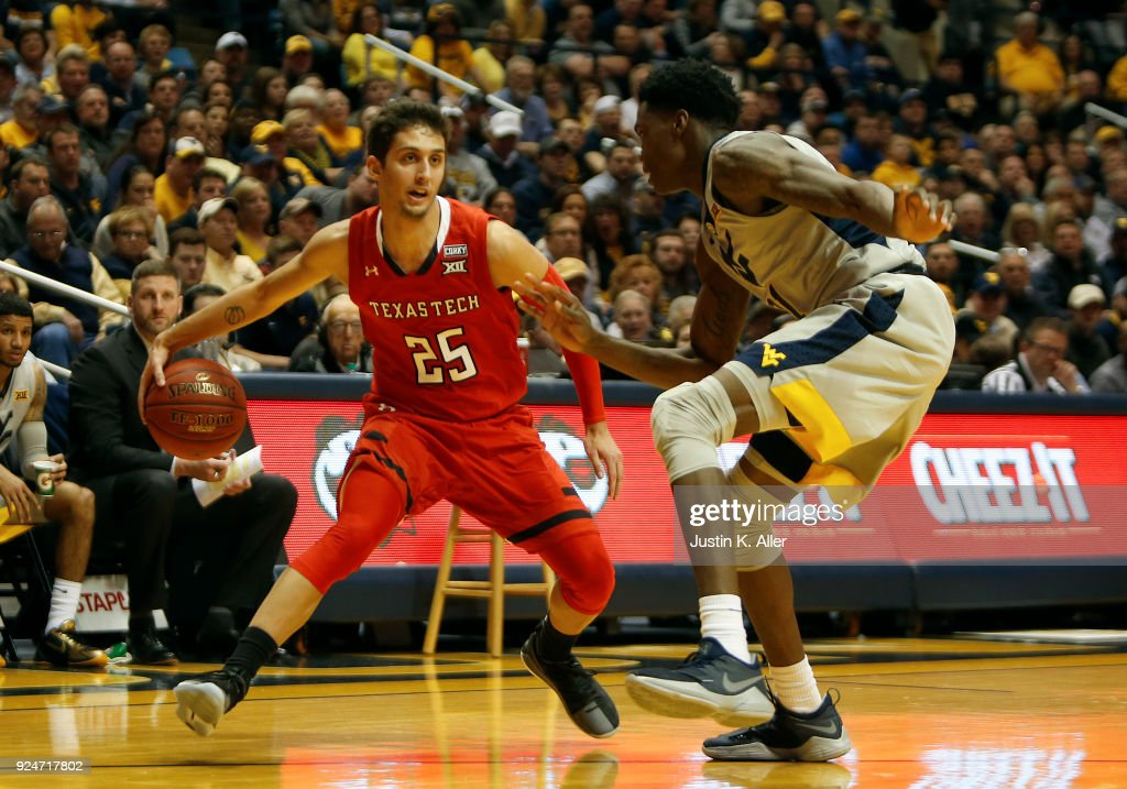 Davide Moretti #25 of the Texas Tech Red Raiders looks to pass against the West Virginia Mountaineers at the WVU Coliseum on February 26, 2018 in Morgantown, West Virginia.