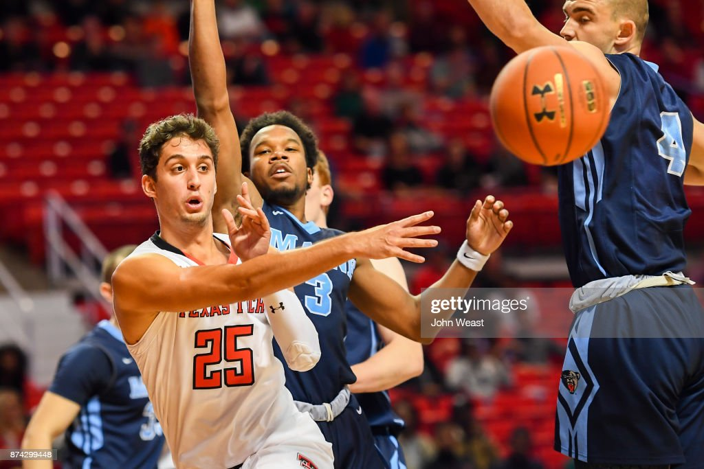 Davide Moretti #25 of the Texas Tech Red Raiders passes the ball from under the basket during the game against the Maine Black Bears on November 14, 2017 at United Supermarkets Arena in Lubbock, Texas. Texas Tech defeated Maine 83-44.