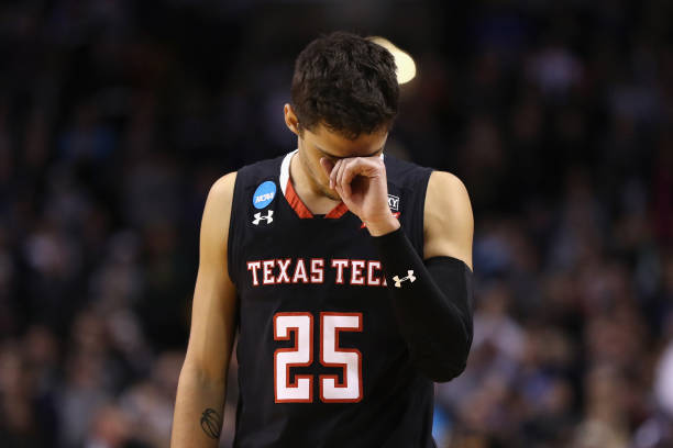 Davide Moretti of the Texas Tech Red Raiders reacts during the second half against the Villanova Wildcats in the 2018 NCAA Men's Basketball...
