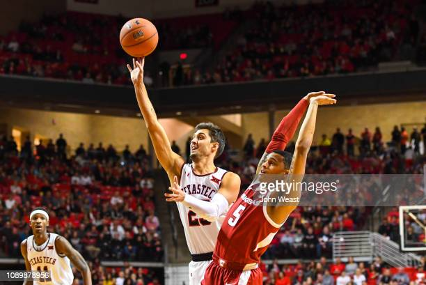 Davide Moretti of the Texas Tech Red Raiders shoots the ball over Jalen Harris of the Arkansas Razorbacks during the first half of the game on...