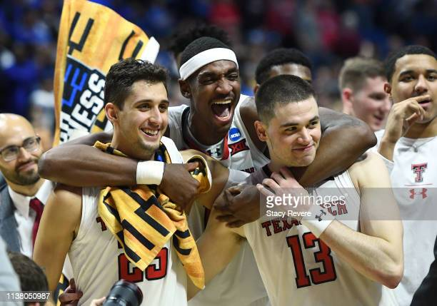Davide Moretti Tariq Owens and Matt Mooney of the Texas Tech Red Raiders celebrate their 7858 victory over the Buffalo Bulls after their second round...