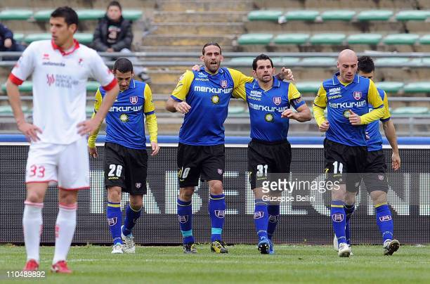 Davide Moscardelli of Chievo Verona celebrates scoring his team's second goal with team-mates Sergio Pellissier , Roberto Guana and Mariano...