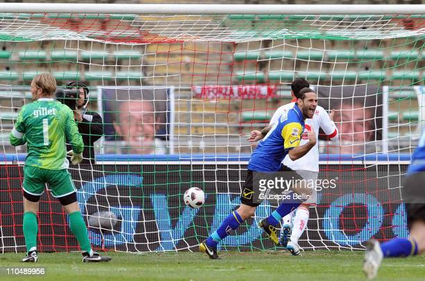Davide Moscardelli of Chievo Verona turns to celebrate scoring the second goal for his team past goalkeeper Jean Francois Gillet of AS Bari during...