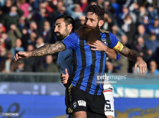 Davide Moscardelli of Pisa SC and Riccardo Idda of Cosenza in action during the Serie B match between Pisa SC and Cosenza at Arena Garibaldi on...