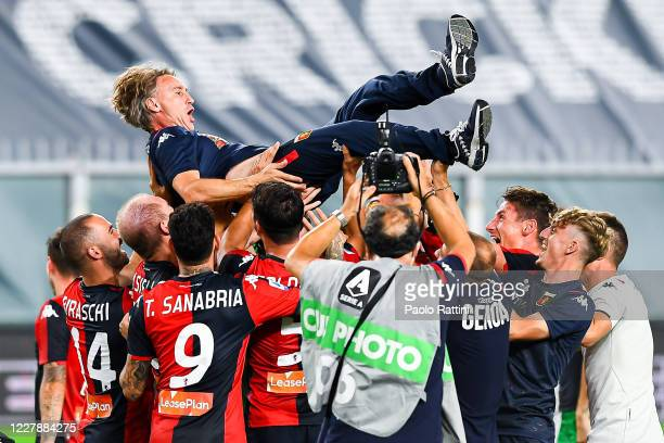 Davide Nicola coach of Genoa is lifted up by his players in celebration after the Serie A match between Genoa CFC and Hellas Verona at Stadio Luigi...