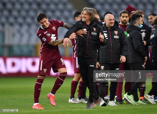 Davide Nicola, Head Coach of Torino F.C. Celebrates with Daniele Baselli after the Serie A match between Torino FC and AS Roma at Stadio Olimpico di...