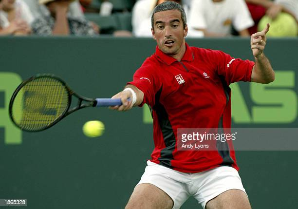 Davide Sanguinetti of Italy returns a shot to Marat Safin of Russia during the Nasdaq100 Open on March 22 2003 at the Tennis Center at Crandon Park...