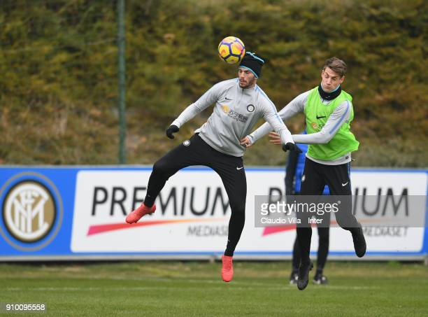 Davide Santon and Andrea Pinamonti compete for the ball during the FC Internazionale training session at Suning Training Center at Appiano Gentile on...