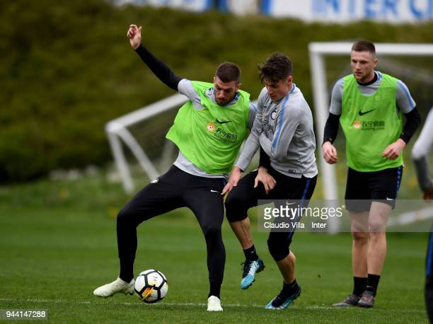 Davide Santon and Andrea Pinamonti of FC Internazionale compete for the ball during the FC Internazionale training session at the club's training...
