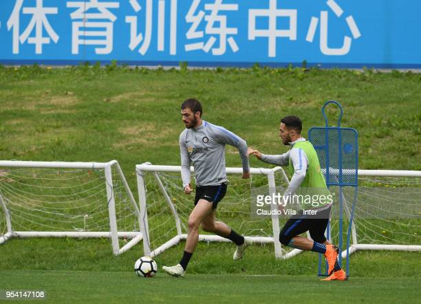 Davide Santon and Danilo D'Ambrosio of FC Internazionale compete for the ball during the FC Internazionale training session at the club's training...