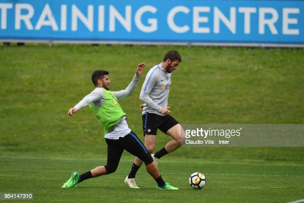Davide Santon and Lisandro Lopez of FC Internazionale compete for the ball during the FC Internazionale training session at the club's training...