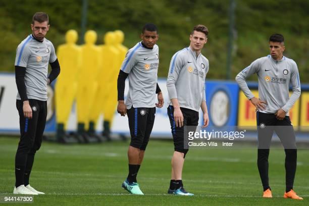 Davide Santon Dalbert Henrique Chagas Estevão Andrea Pinamonti and Joao Cancelo of FC Internazionale look on during the FC Internazionale training...