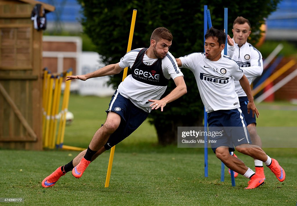 Davide Santon (L) in action during FC Internazionale training session at the club's training ground at Appiano Gentile on May 22, 2015 in Como, Italy.