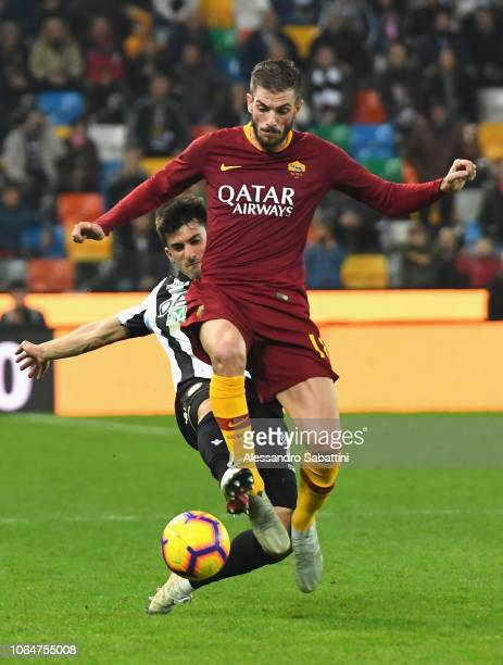 Davide Santon of AS Roma competes for the ball with Ignacio Pussetto of Udinese Calcio during the Serie A match between Udinese and AS Roma at Stadio...